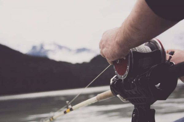 close-up-of-man-holding-a-fishing-rod_web-1000